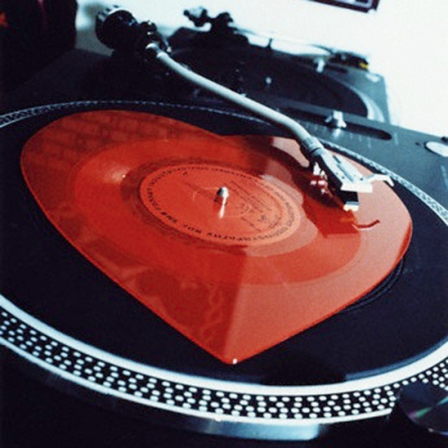 Heart-shaped record on turntable